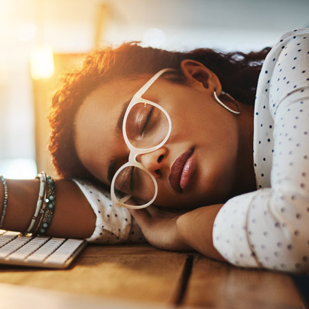 burned out business woman asleep at desk